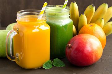 Fresh fruit juice in the jar. on dark background.