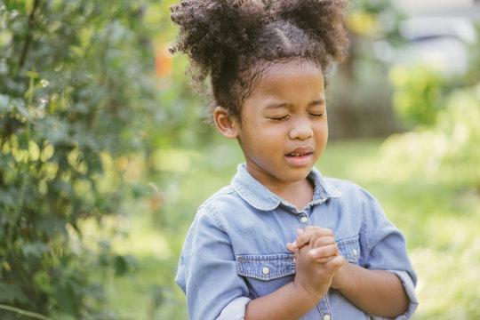 little girl praying. kid prays. Gesture of faith.Hands folded in prayer concept for faith,spirituality and religion