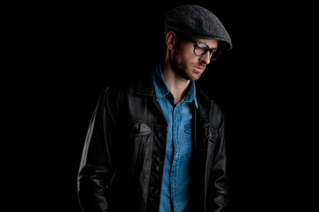 man with black leather jacket looking away