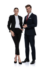 couple in business suits standing with hands together