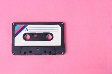Audio retro vintage cassete tape 80s style on pink background