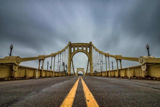 Yellow suspension bridge in Pittsburgh Pennsylvania.