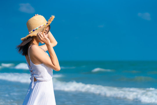 Woman relaxing on the beach. Woman relaxing on the beach. .Vacation lifestyle.