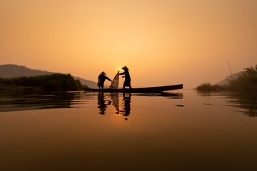 Fishermen are working on the fishing boat in Mekong River during in the morning in Nong Khai.