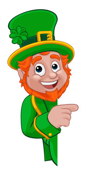 A Leprechaun St Patricks Day Irish cartoon character peeking around a sign or banner and pointing