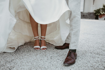 bride and grooms shoes on a wedding