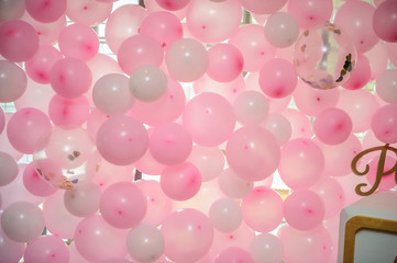 wall of pink balloons at a party