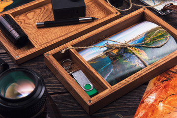 Wooden photo box with photo from travel. Decorated with different things. Travel concept.