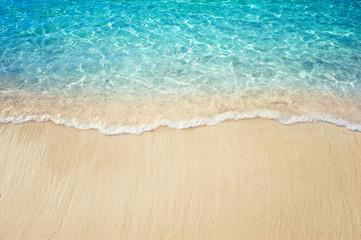 Wall Mural - Soft blue ocean wave on clean sandy beach