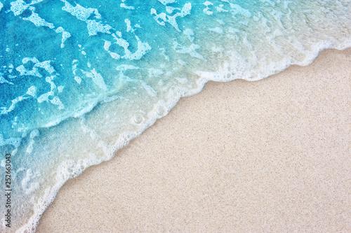 Fototapete Soft blue ocean wave on clean sandy beach