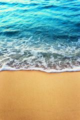 Fototapete - Soft blue ocean wave on clean sandy beach
