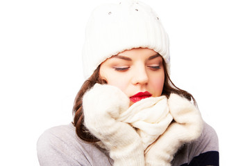 girl in white hat and scarf is frozen