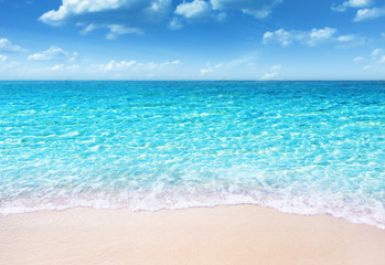 Wall Mural - tropical sandy beach and soft blue ocean wave summer concept background