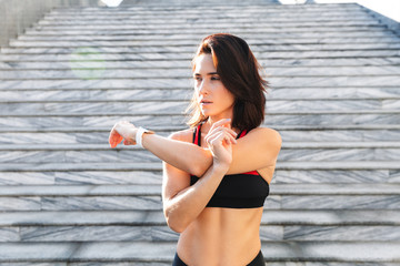 Beautiful young sports woman doing stretching