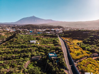 Volcano in Tenerife, El Teide. View from a drone with lands of grapevine and a blue sky Aerial picture