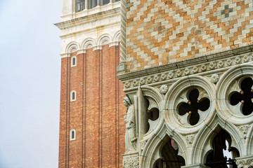 Detail view of the Doge's Palace and St. Mark's Bell Tower in Venice, Italy. Palace build in Venetian Gothic style.