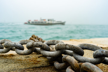 Rusty Ship Anchor Chain On Dry Coast In The Port.