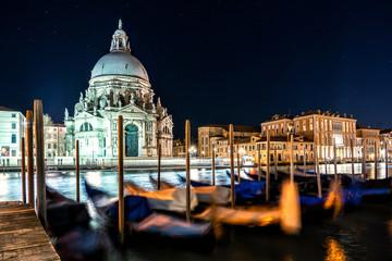 Night shot of Grand Canal and Basilica Santa Maria della Salute, Venice, Italy.