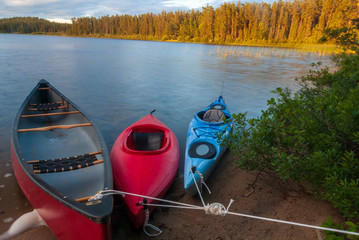 canoes and kayaks on shore