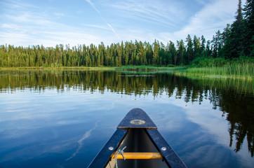bow of canoe on lake