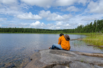 man sitting at lake