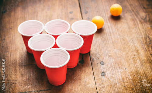 Beer Pong Plastic Red Color Cups And Ping Pong Balls On