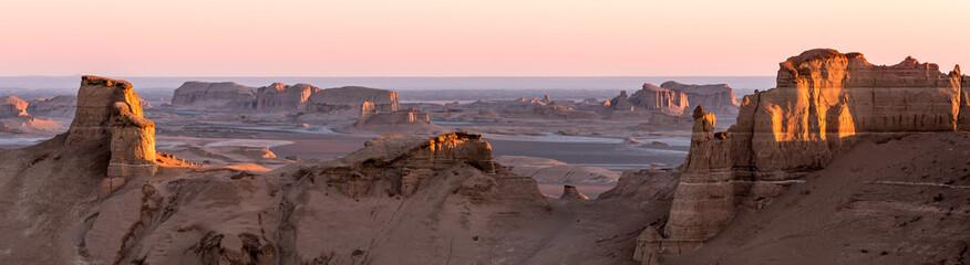 Obraz Panoramic view of sandy mountains in Kaluts desert, part of Dasht-e Lut desert during sunrise, Iran - fototapety do salonu