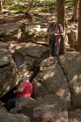 men climbing on rocks