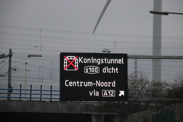 Dynamic route information panel warns for closed tunnel named Koningstunnel on S100 in The Hague on highway A4