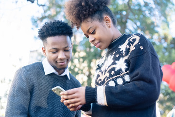 Couple checking phone together