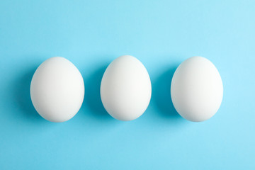 Chicken eggs on color background, space for text