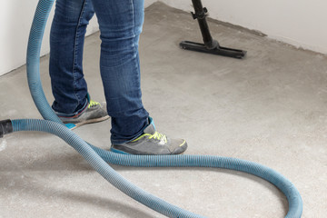 man in denim pants. makes cleaning of production rooms. apartment after repair using polysosa.
