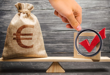 Magnifying glass is looking at a bag with euro money and a red check mark of a voice on scales. Intervention in the political processes. lobbying for laws and regulations in favor of businessmen.