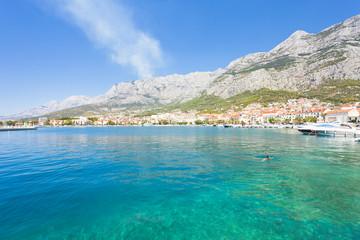Makarska, Dalmatia, Croatia - A woman swimming in the bay of Makarska