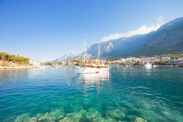 Makarska, Dalmatia, Croatia - A touristic party boat leaving the harbor of Makarska