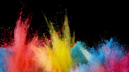 Fototapete - Explosion of colored powder on black background