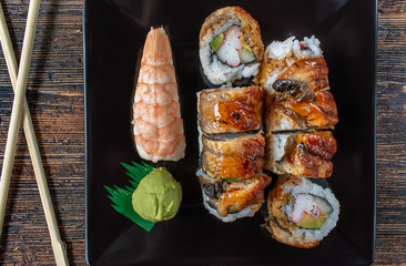 fresh assortment of sushi with eel, shrimp tails, and California rice rolls flat lay
