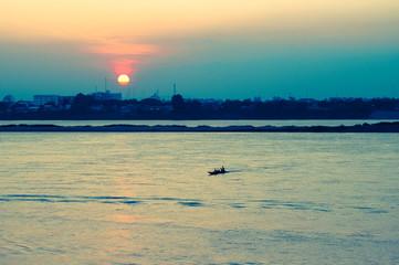 Small boat on River Mekong at sunset, Savannakhet , Laos