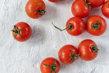 small red ripe tomatoes with stem flat lay on white background