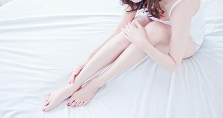 asian woman touch her leg