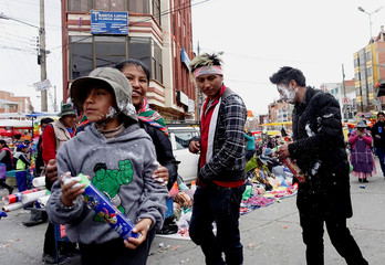 People play with foam spray during Carnival celebrations in El Alto