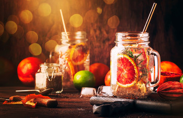 Summer cold detox drink with red orange, citrus fruit juice and chia seeds. Healthy fitness drink. Ingredients for cooking on wooden kitchen table background, selective focus