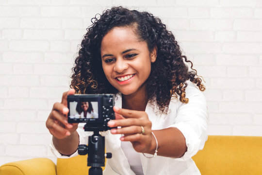 African american woman blogger in front of camera recording herself.social media concept