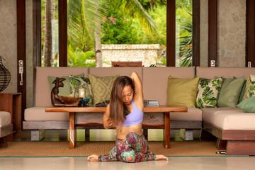 Filipino girl yoga posing in tropical environment