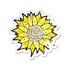retro distressed sticker of a cartoon sunflower