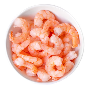 Peeled shrimps in a bowl isolated on white background. Top view.