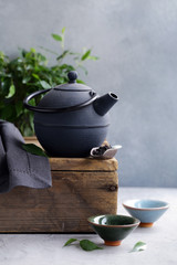 cast iron kettle on wooden table for tea ceremony