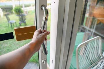 Hand holding handle sliding glass door