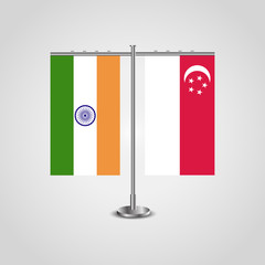 Table stand with flags of India and Singapore.Two flag. Flag pole. Symbolizing the cooperation between the two countries. Table flags