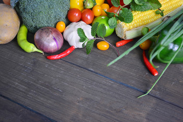 Organic vegetables on white wooden background, Top view.